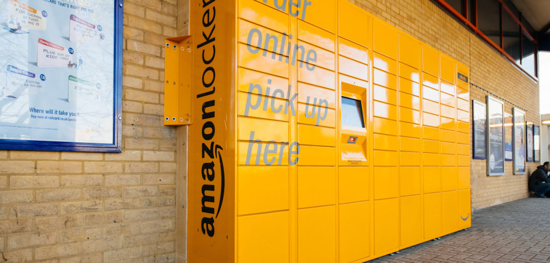 Amazon Locker yellow parcel delivery machine at train statiaon in UK © AdrianHancu/GettyImages