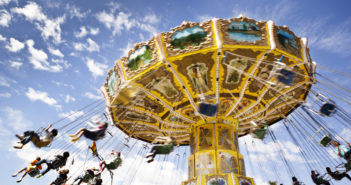 A carnival ride with swings in motion on a cloudy day leisure